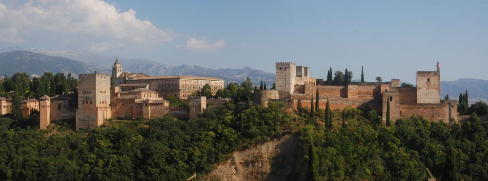 The Alhambra Palace, Granada, with Sierra Nevada rising behind